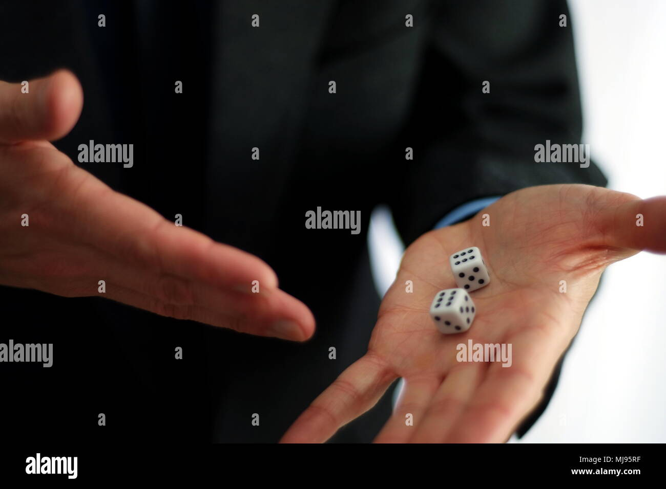 Dices in hand - Stock Image