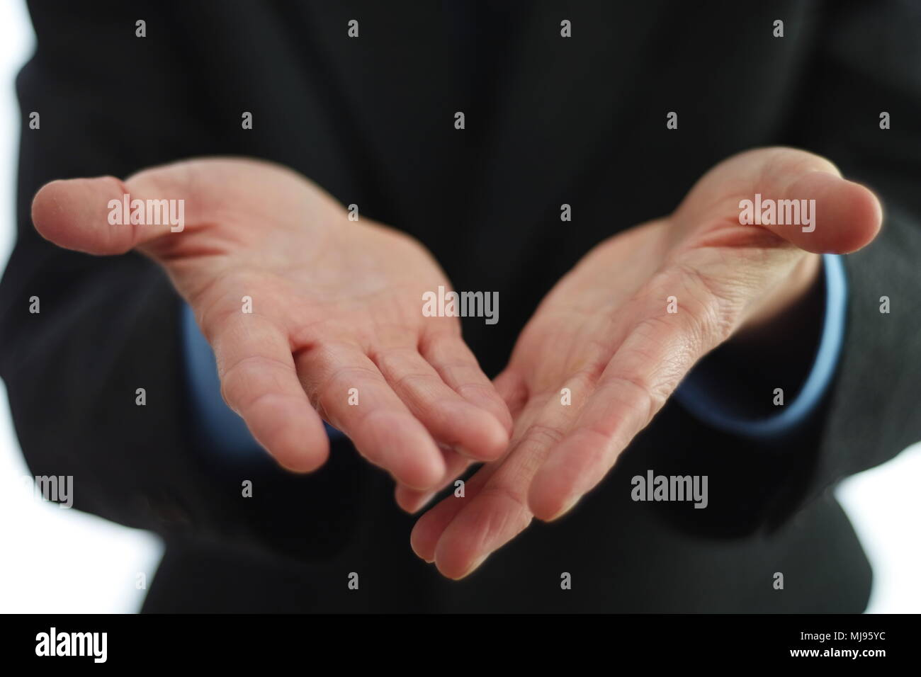 Offering something with hands Stock Photo