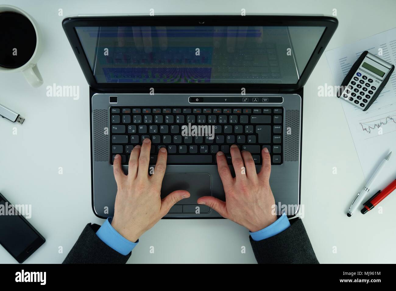 Working on a laptop - Stock Image