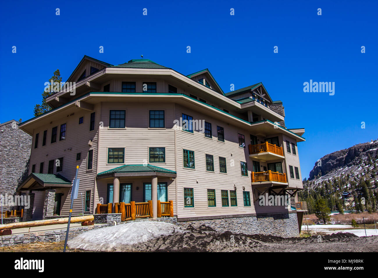 Multi Story Building In Mountains - Stock Image