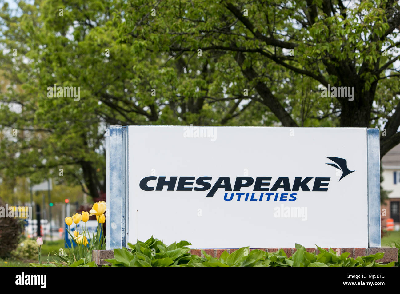 A logo sign outside of a facility occupied by the Chesapeake Utilities Corporation in Dover, Delaware on April 29, 2018. - Stock Image