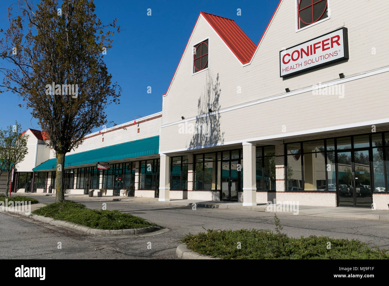 A logo sign outside of a facility occupied by Conifer Health Solutions in Annapolis, Maryland on April 29, 2018. - Stock Image