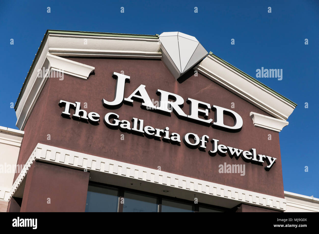 A logo sign outside of a Jared the Galleria of Jewelry retail store