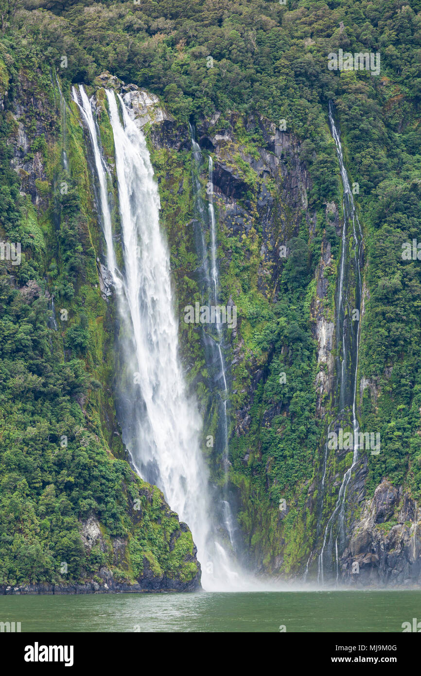 Milford sound New Zealand Milford sound stirling falls waterfall fiordland national park new zealand South Island nz fjordland national park nz - Stock Image