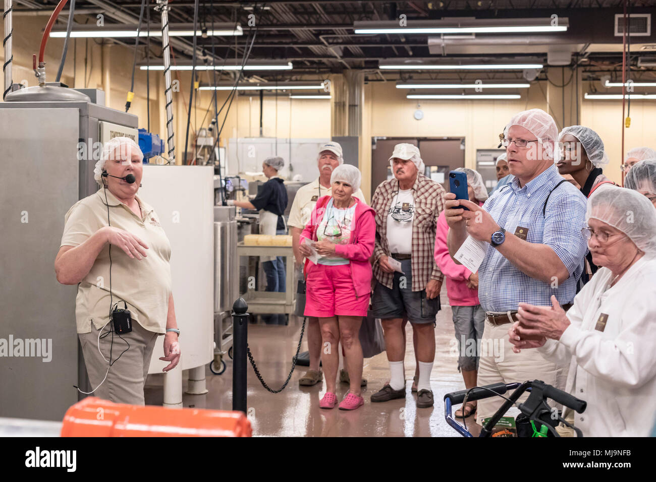 St. Augustine, Florida - A tour group visits the Whetstone Chocolates factory. The company makes and sells artisan chocolates in St. Augustine's histo - Stock Image