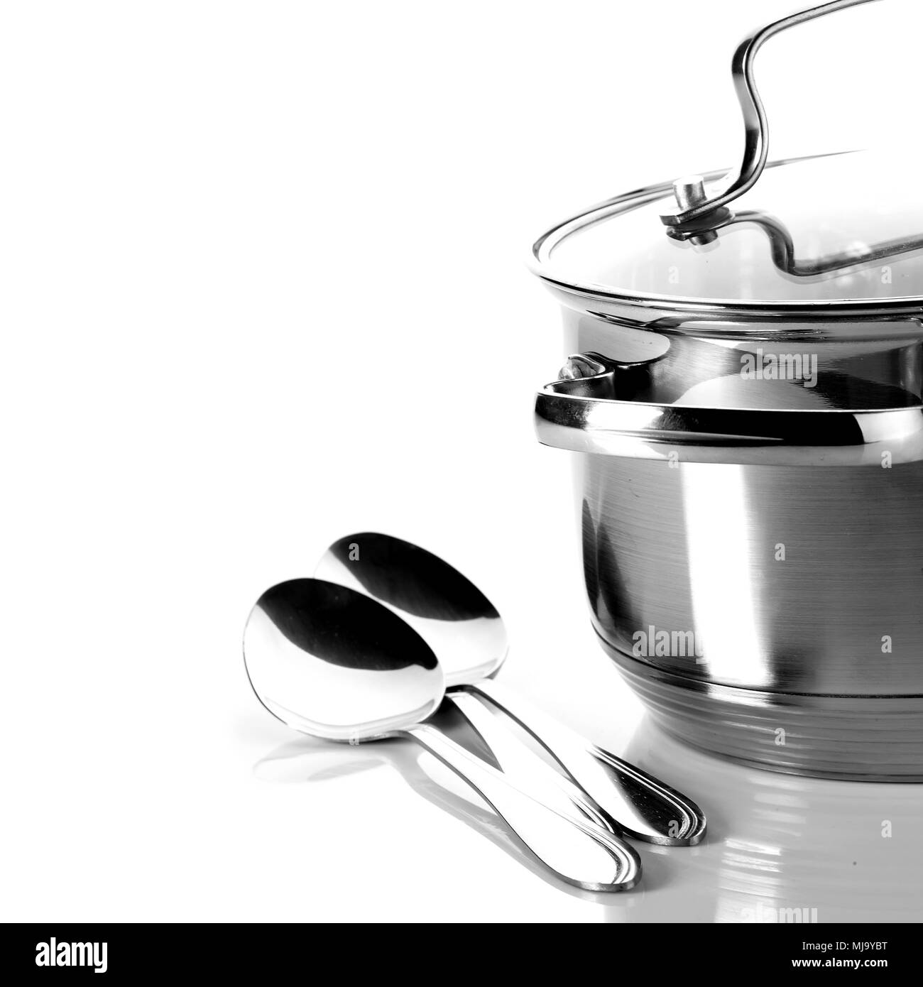 Pan and spoons. Kitchen utensils. Ware. - Stock Image