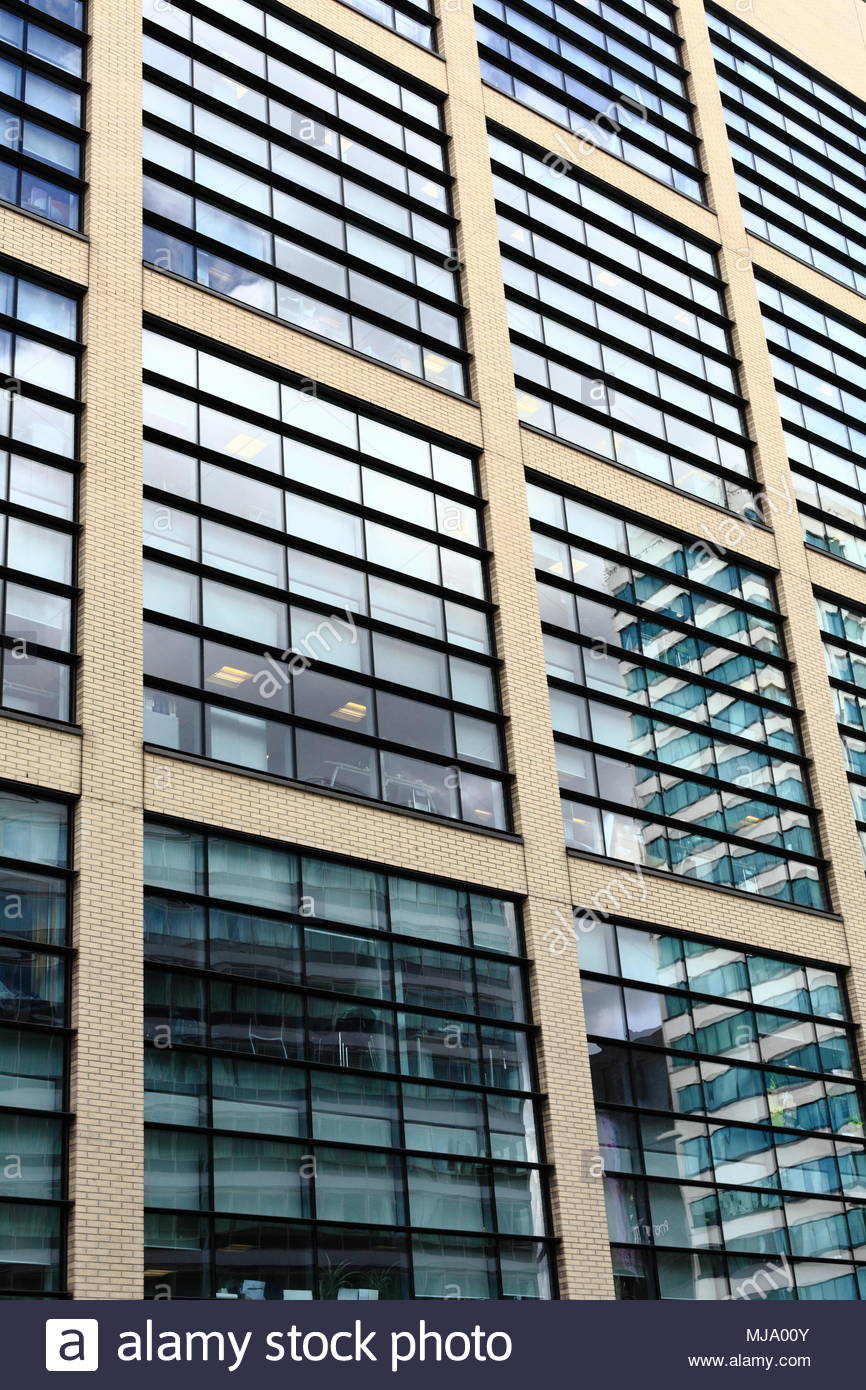 point of view image of modern architecture featuring glass panel windows in Manchester City centre Manchester England May 2018 - Stock Image