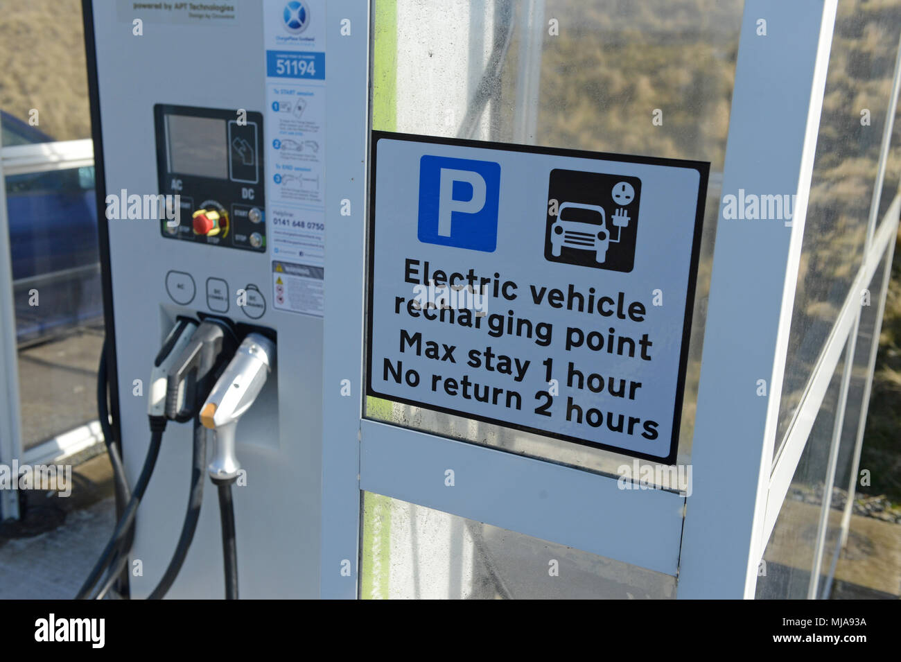 Electric car charging point in a rural location inside a shelter Stock Photo