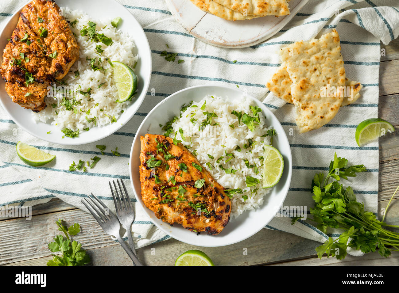 Homemade Indian Tandoori Chicken with Rice and Naan Bread - Stock Image