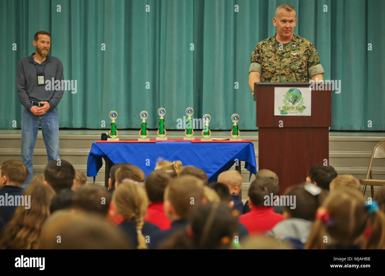 """Lt. Col. Matthew Stover adresses students during the Earth Day poster award ceremony aboard Laurel Bay, April 24. Children from Charles F. Bolden Elementary School and Elliott Elementary School competed in the poster contest as a way to educate and involve children on environmental management. This year's theme for the contest was """"Give a hoot, Don't Pollute."""" April 22 has been designated as Earth Day since 1970 and across the Marine Corps, installations are participating in Earth Day activities to help remind all Marines, Sailors, civilians, and their families that their everyday actions help - Stock Image"""