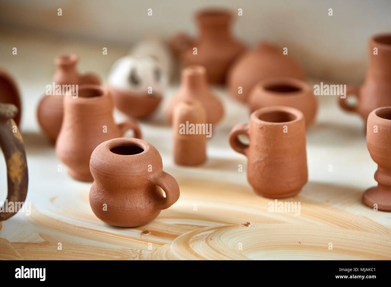 Ceramic Dishware On Worktop And Shelves In Pottery Workshop Selective Focus Close Up Plain Clay Mugs Oraganized In The Workshop Place Simple Porce Stock Photo Alamy