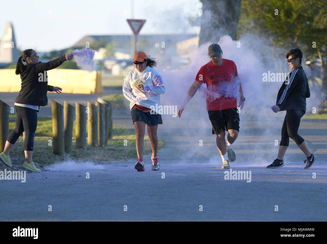 Keesler personnel participate in the Air Force Assistance Fund Color Run at Keesler Air Force Base, Mississippi, April 20, 2018. The AFAF raises funds for charitable affiliates that provide support to Air Force families in need. (U.S. Air Force photo by Kemberly Groue) - Stock Image