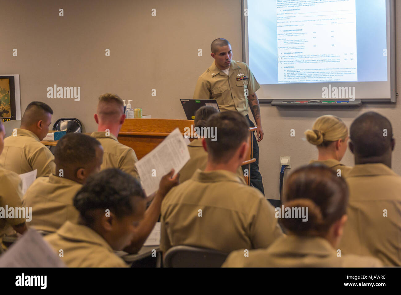 U S  Navy Corpsmen review paperwork and receive a safety