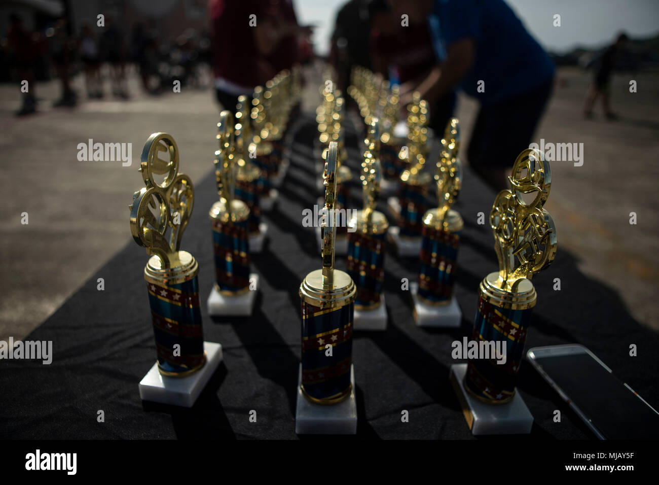 Trophies for top competitors are displayed during the Koa