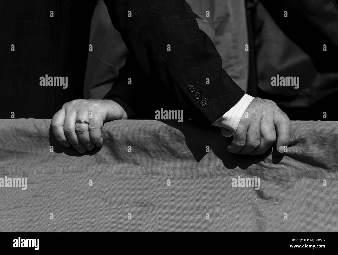 hands of men talking to each other - Stock Image
