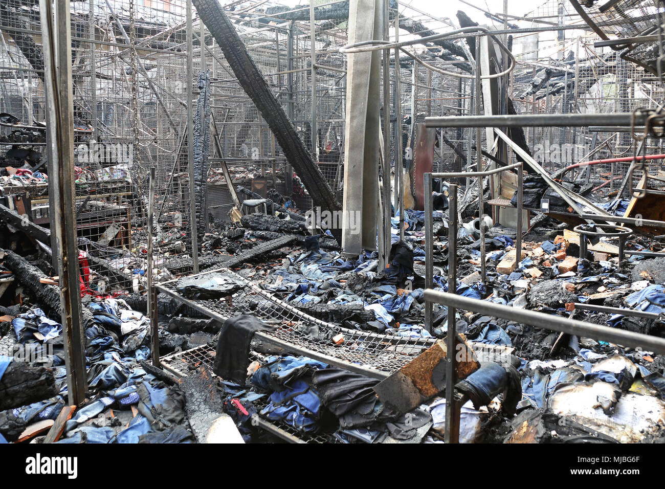 Burned Sweatshop Garment Factory After Fire Disaster - Stock Image