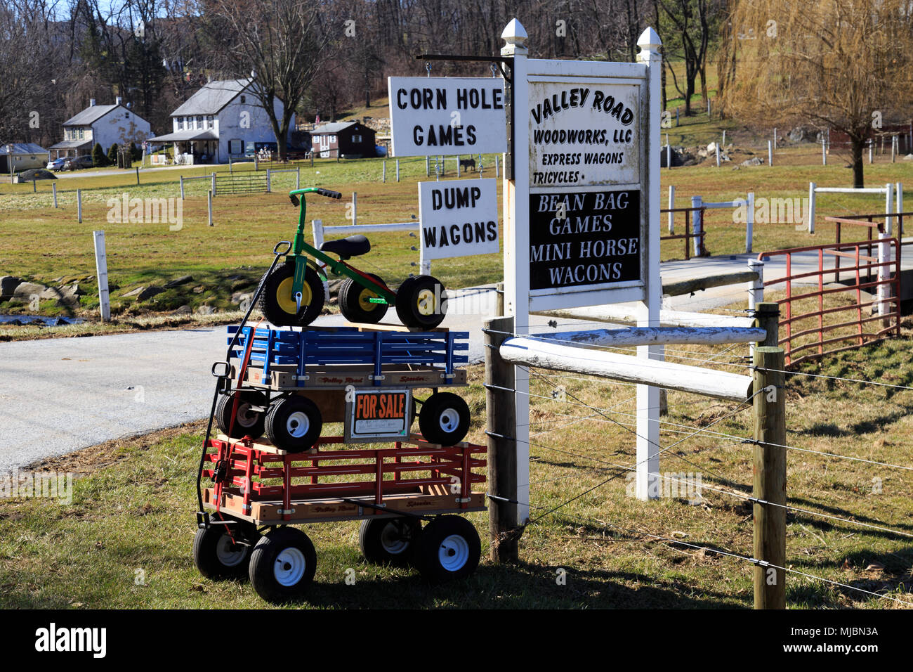 Bart, PA, USA - March 1, 2016: A tricycle stacked on wagons at the end of a rural farm lane in Lancaster County, PA. - Stock Image