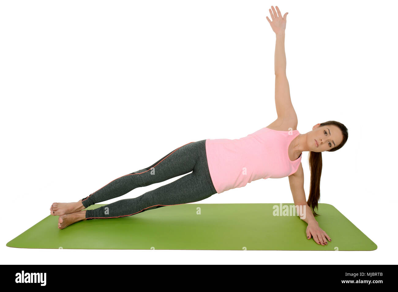 Young woman doing yoga asana Vasisthasana ,Side Plank - Stock Image