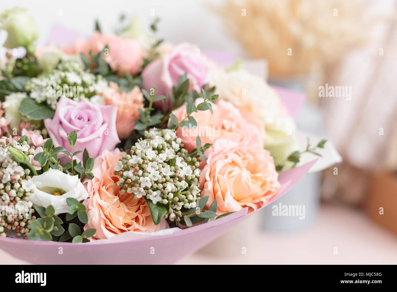 Pastel Orange And Lilac Bouquet Of Beautiful Flowers On Wooden Table