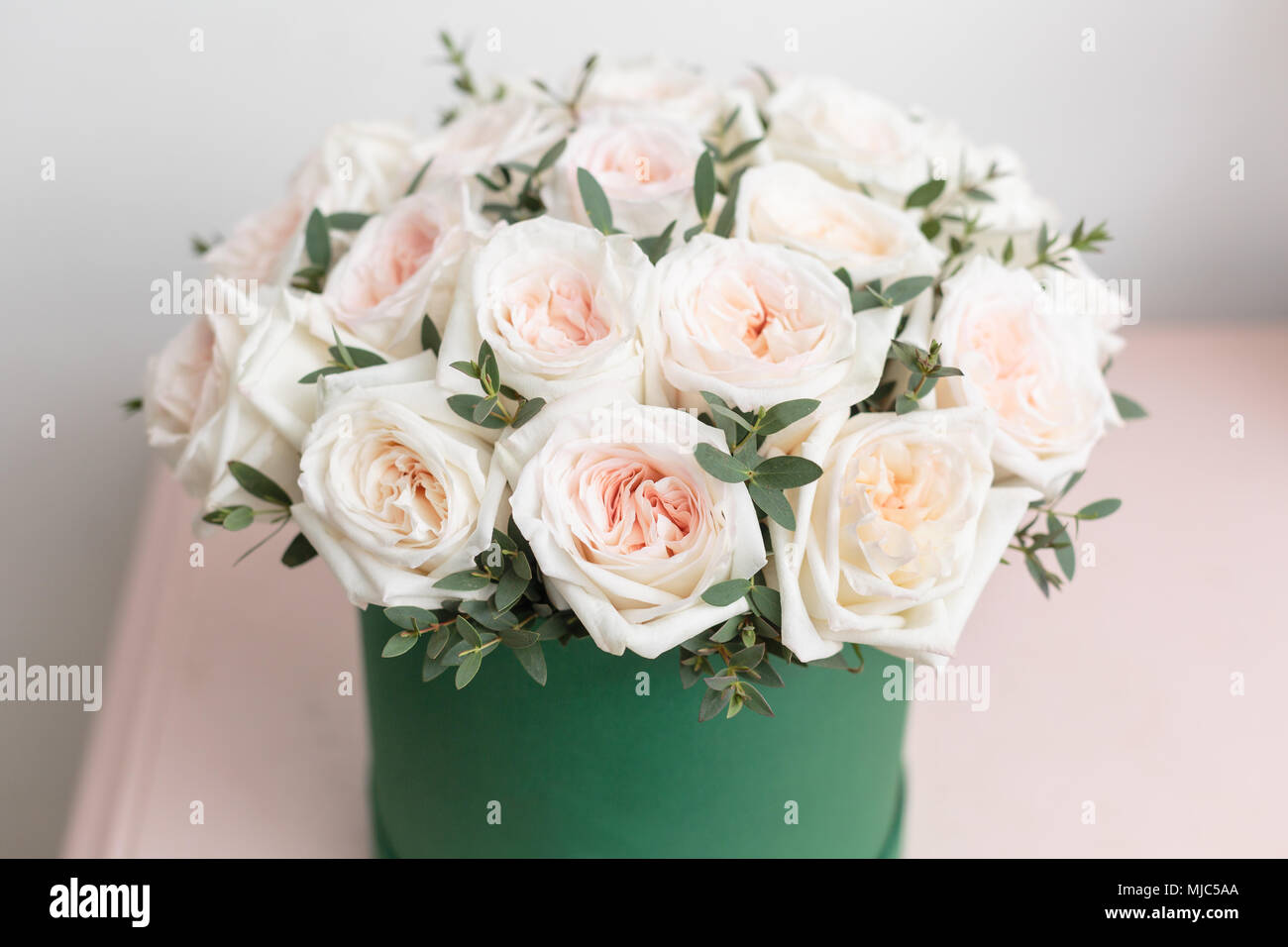 White And Pink Roses Bouquet Of Beautiful Flowers On Wooden Table