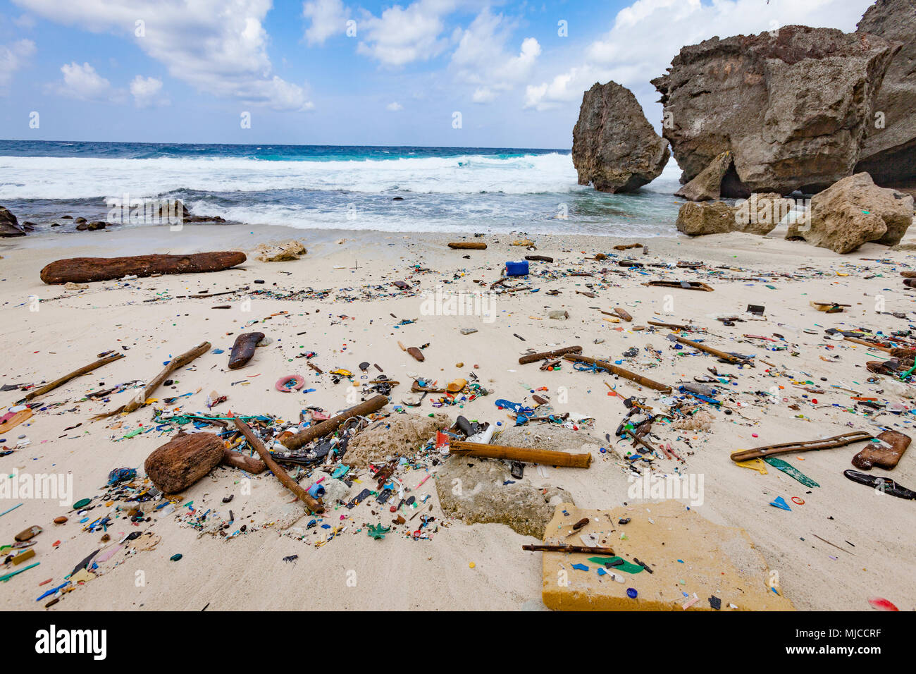 Plastic garbage on the beach of the island Christmas Island in the Indian Ocean - Stock Image