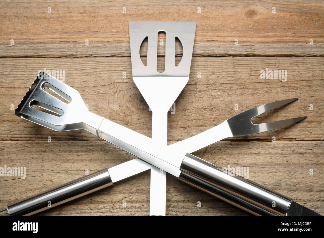 Kitchen Utensils on Wooden Background - Stock Image