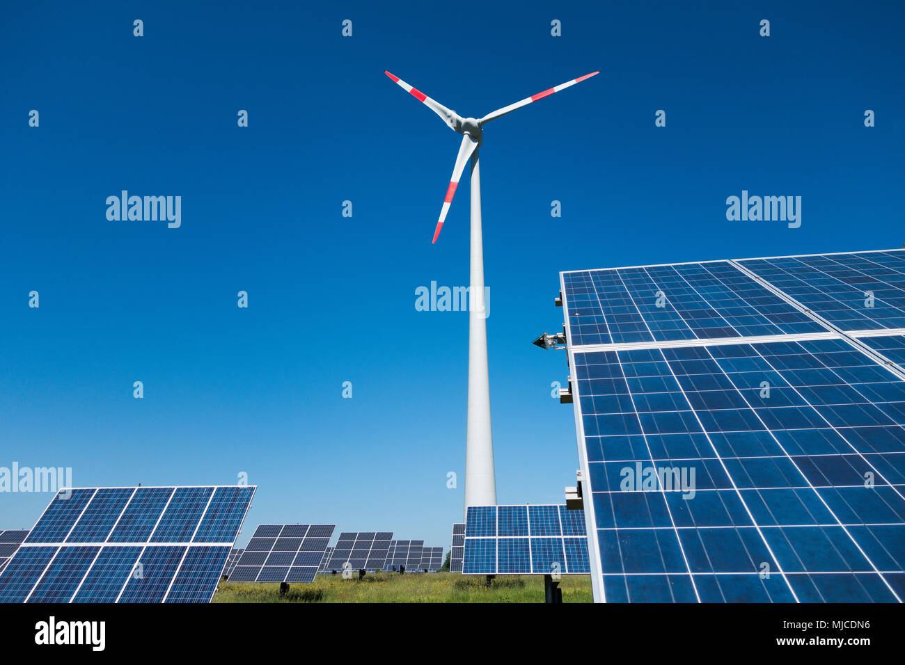 a combination of windpower and solarpower, windmill and solarpanel - Stock Image