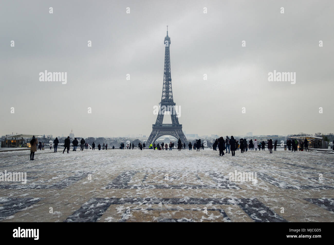 Paris, France - 8 February 2018 : people enjoying the Eiffel Tower under the snow, from the Trocadero - Stock Image