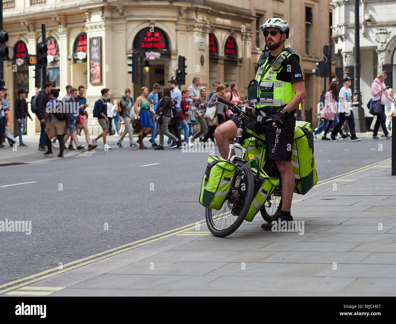 NHS London Ambulance Paramedic on a bicycle in London, UK. 2018. - Stock Image