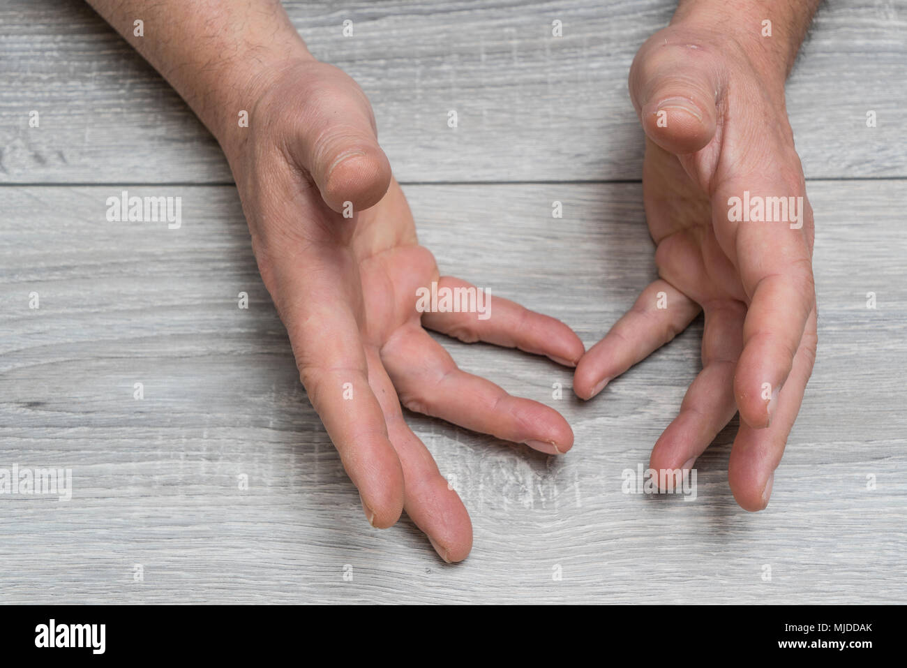 the gesture of a man's hands during an argument - Stock Image