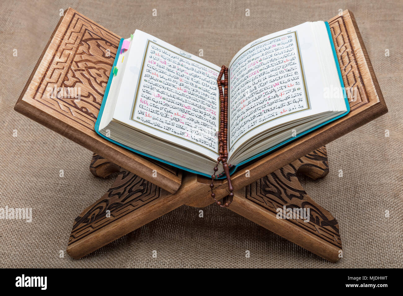 Quran - holy book of Muslims around the world, placed on a wooden stand . - Stock Image