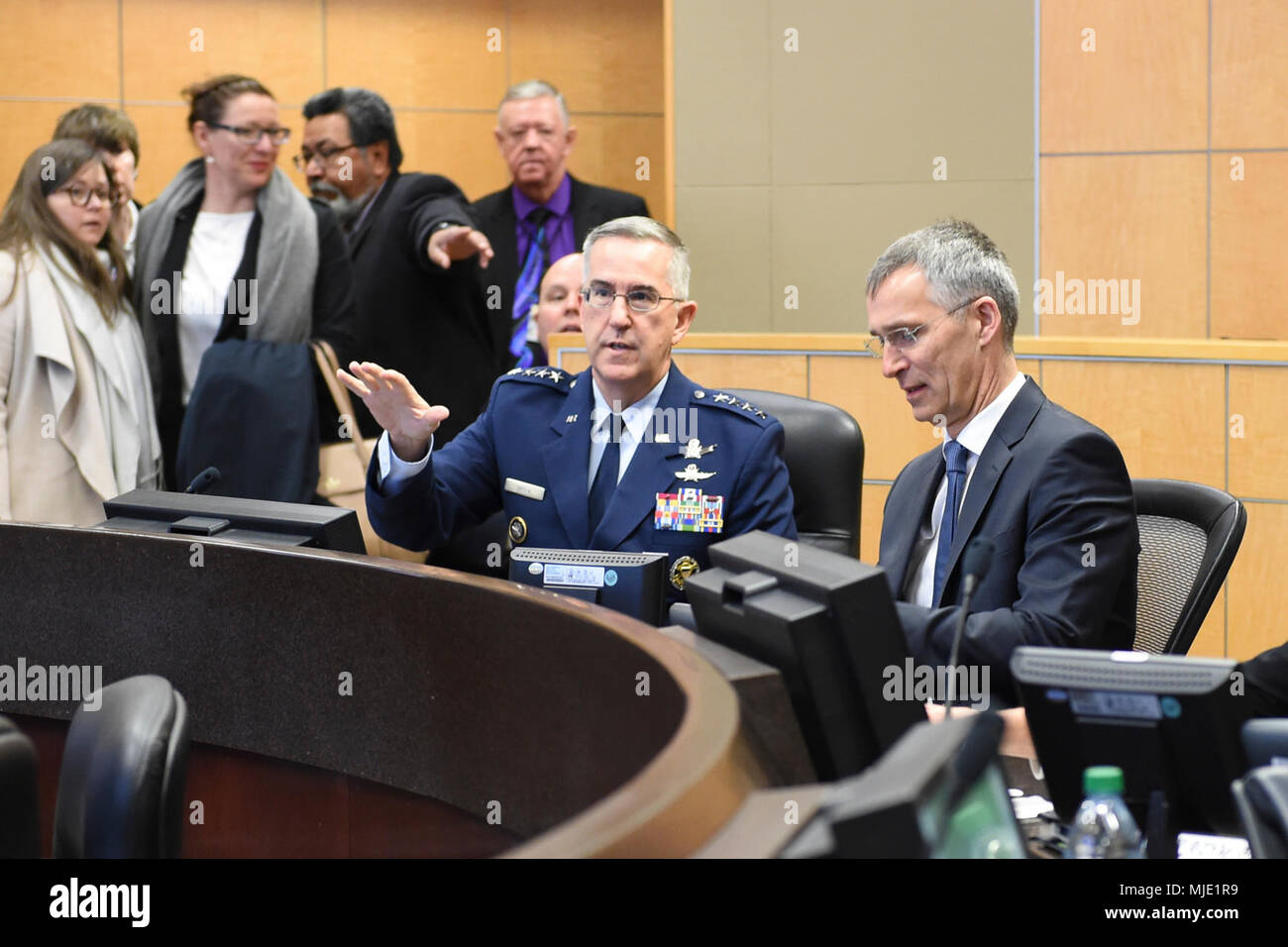 NATO Secretary General Jens Stoltenberg is briefed by U S