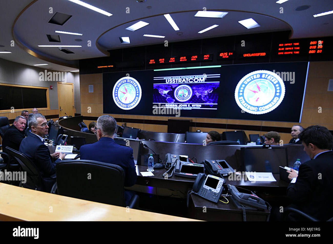 NATO Secretary General Jens Stoltenberg receives a brief from U S
