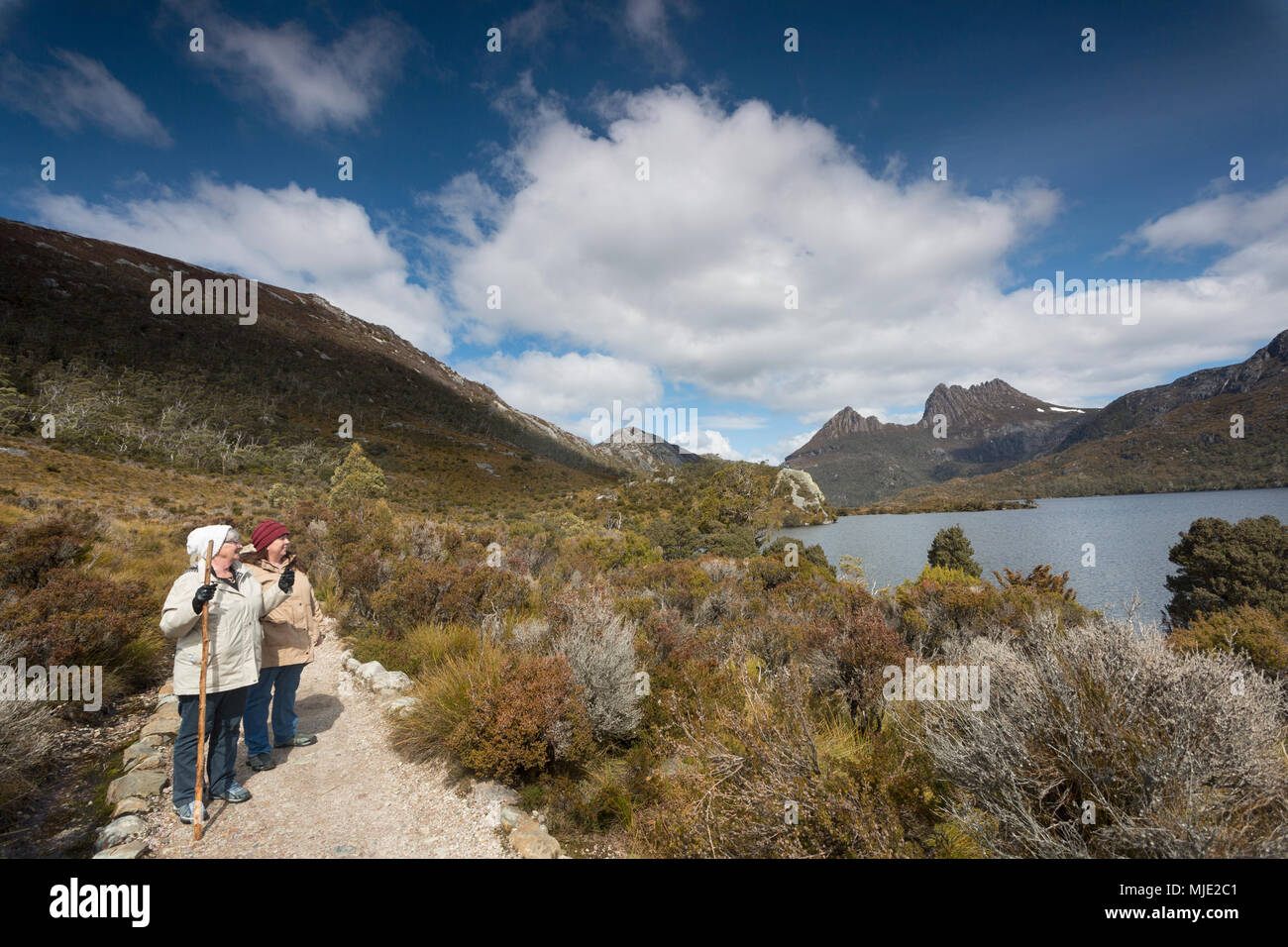 A mother and daughter hiking the trail around Dove Lake at Cradle Mountain national Park. - Stock Image