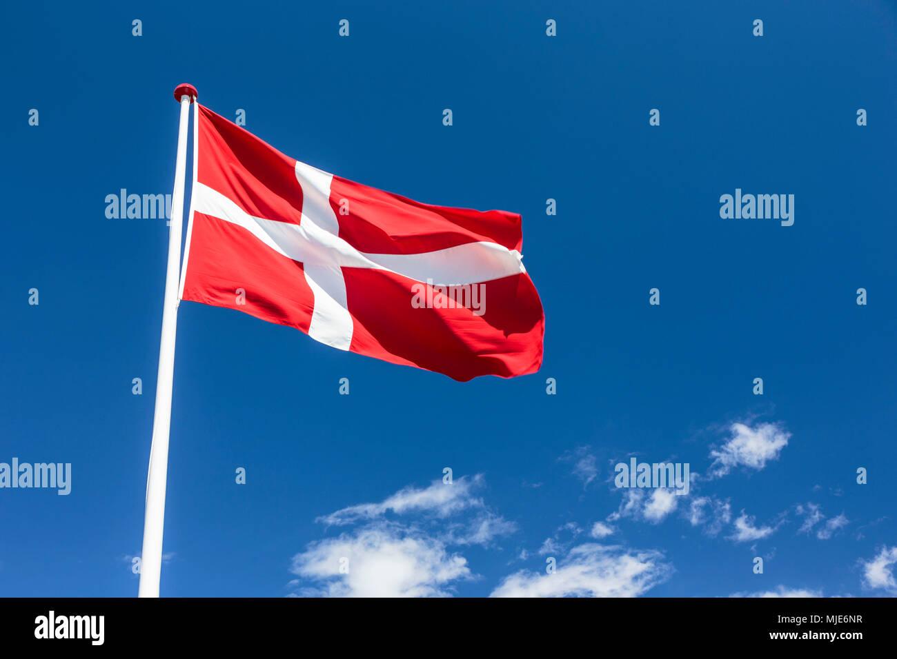 The Danish national flag, the 'Dannebrog' in Bølshavn, Europe, Denmark, Bornholm, Bølsbakke, - Stock Image