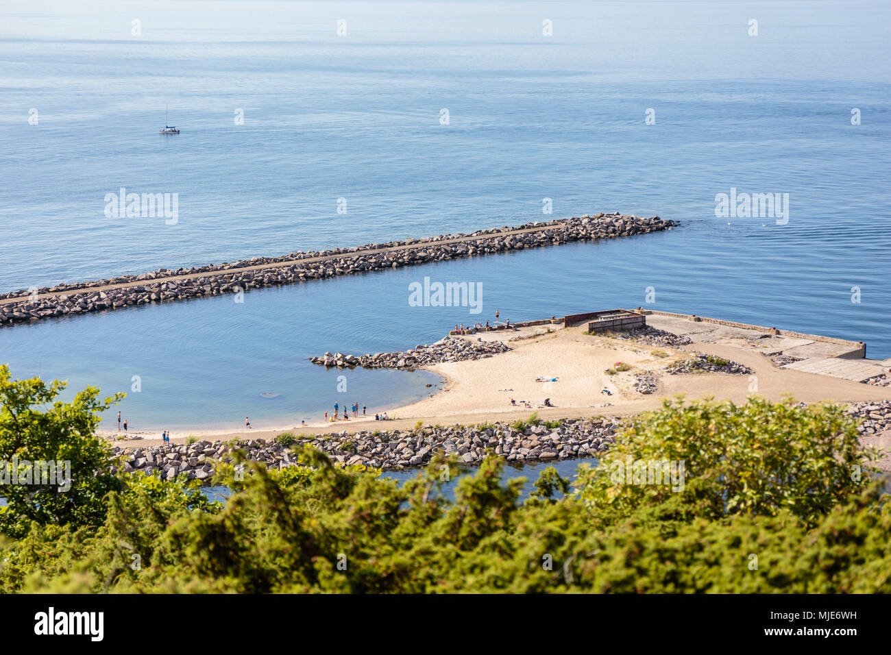 Bathers at the pier of Vang, former port of debarkation of the granite quarry, Europe, Denmark, Bornholm, Stock Photo