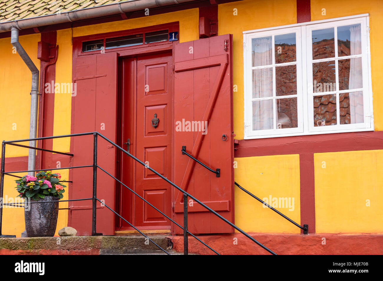 Yellow-red half-timbered house in the old town of Svaneke, Europe, Denmark, Bornholm, Stock Photo