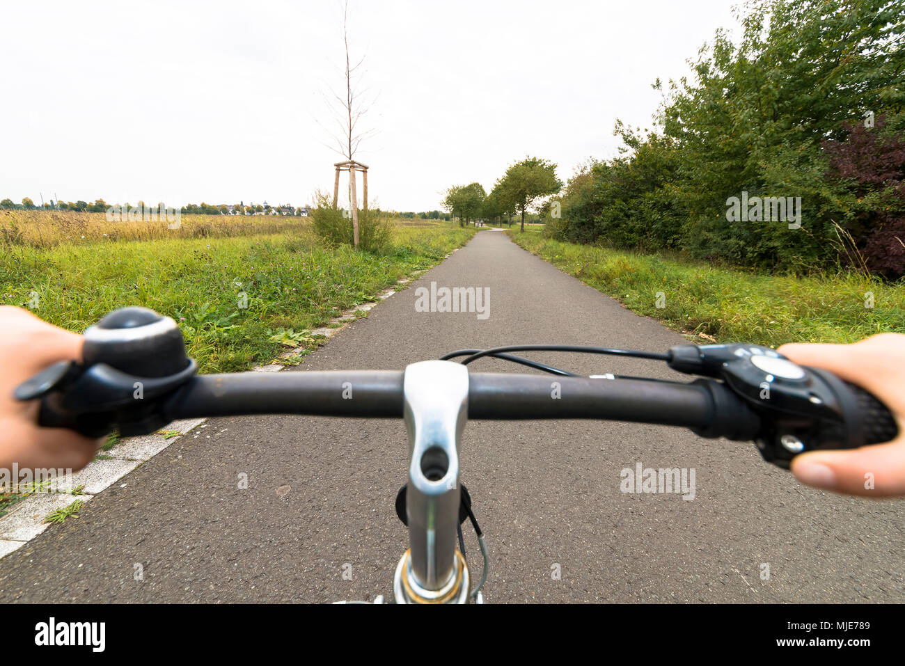 cyclist, detail, hands, handlebars - Stock Image