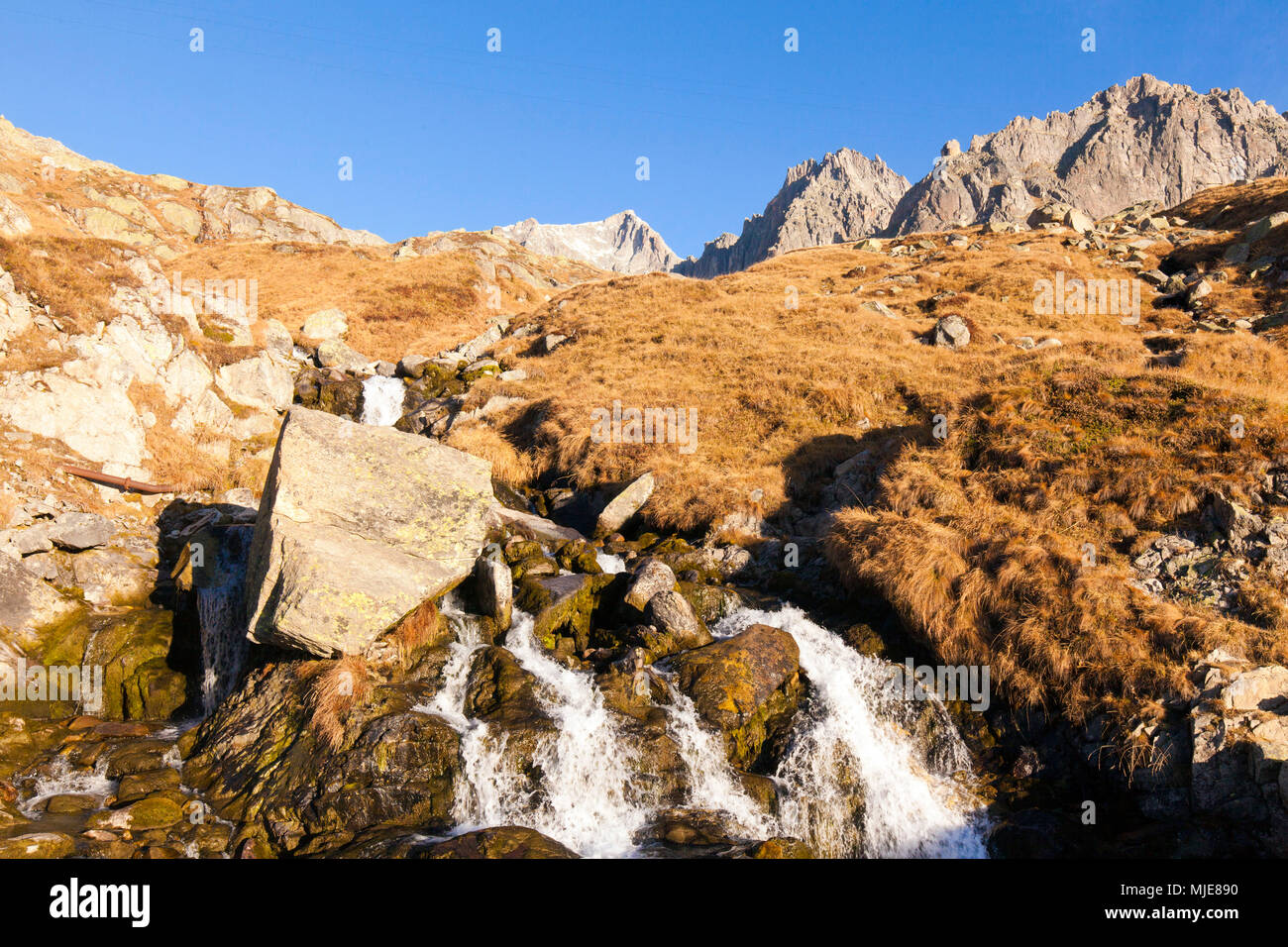Mountain stream under the Tiefenstock (mountain) - Stock Image