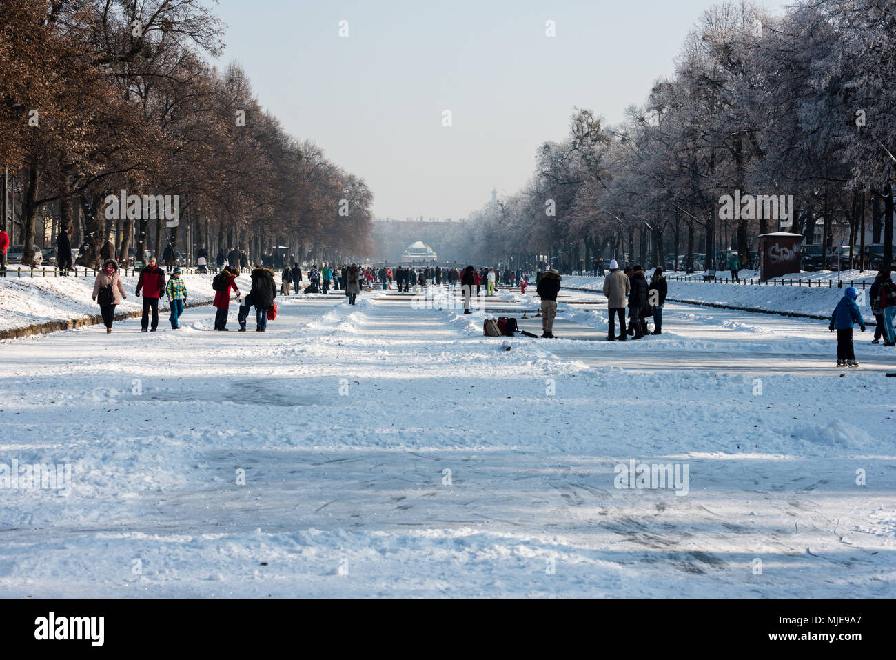 Skaters on the frozen Nymphenburger Kanal in Munich - Stock Image