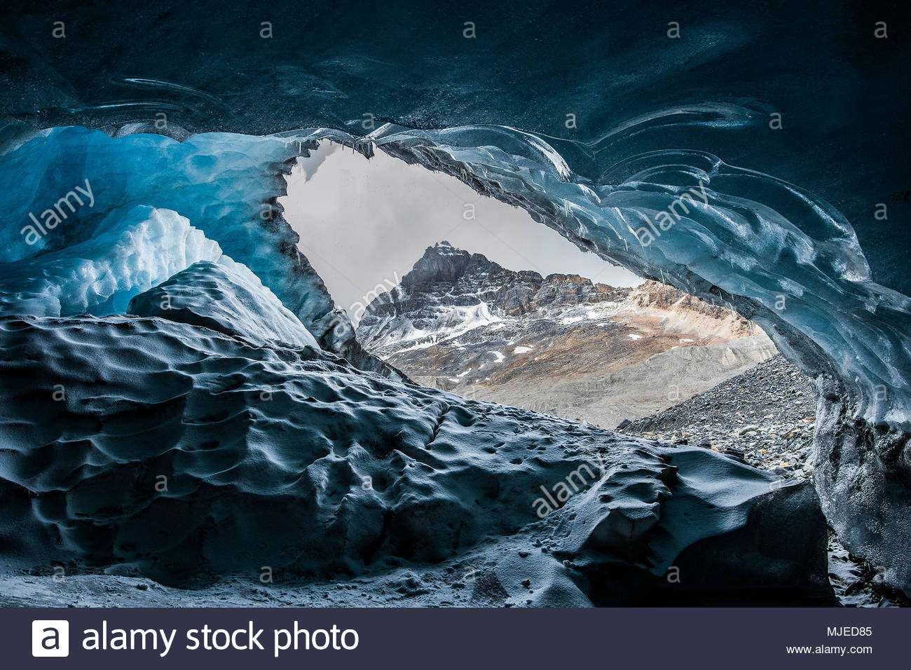 View from an ice cave under a glacier - Stock Image