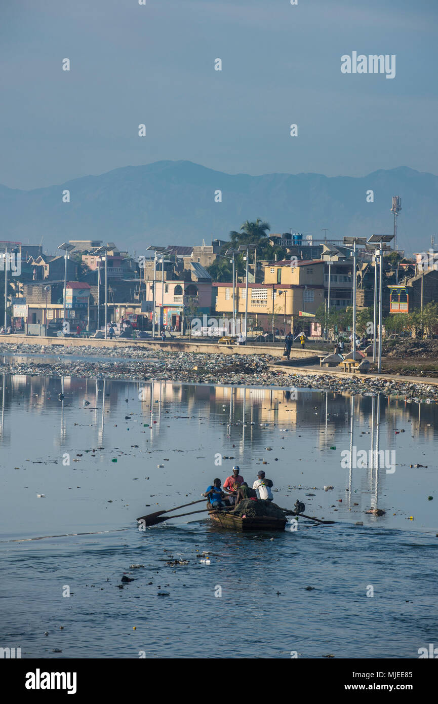 Totally polluted river Mapou flowing through Cap Haitien, Haiti, Caribbean - Stock Image