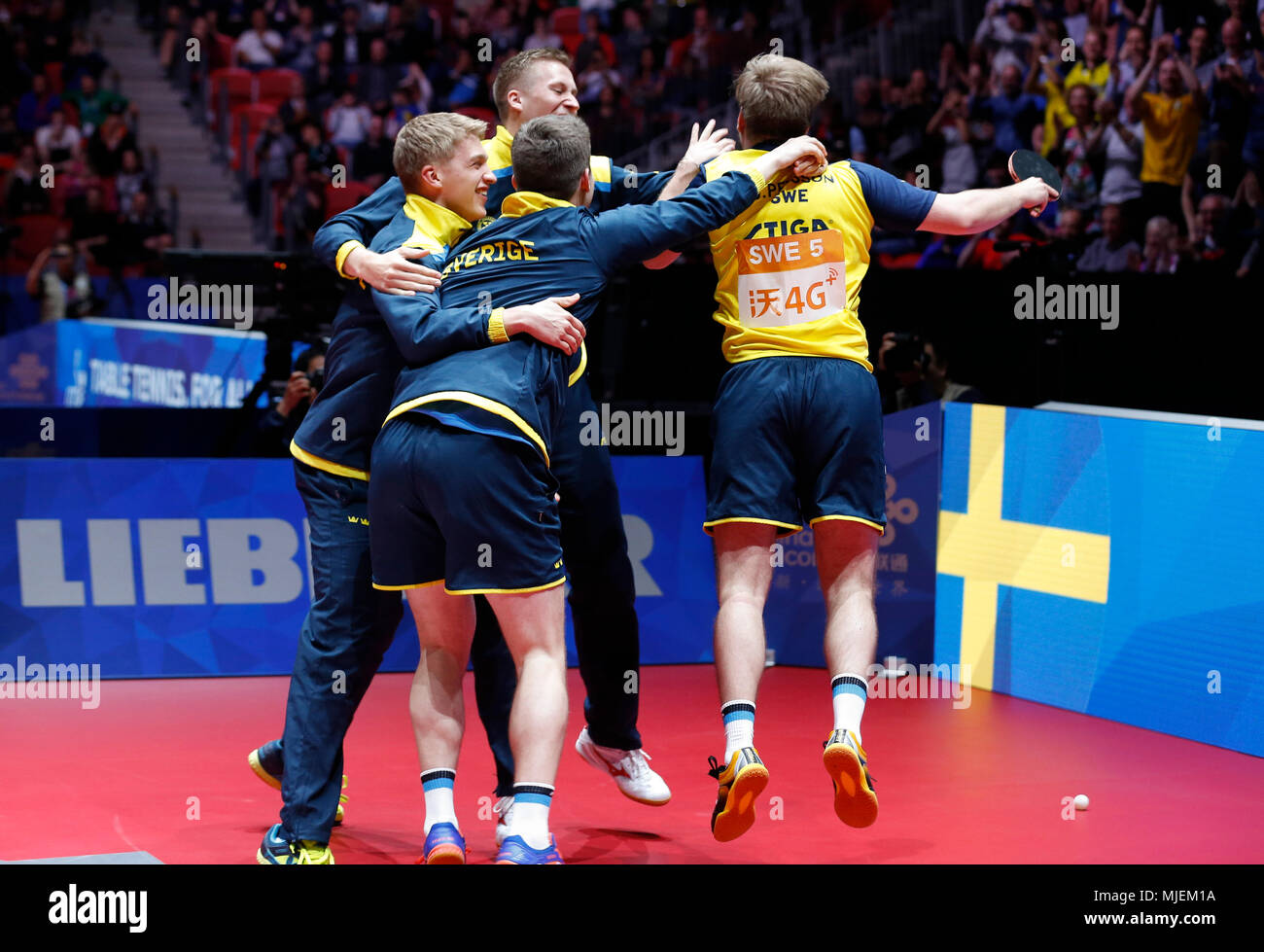 Halmstad, Sweden. 4th May, 2018. Swedish players celebrate after winning England during the Men's group quarterfinal match at the 2018 World Team Table Tennis Championships in Halmstad, Sweden, May 4, 2018. Credit: Ye Pingfan/Xinhua/Alamy Live News - Stock Image