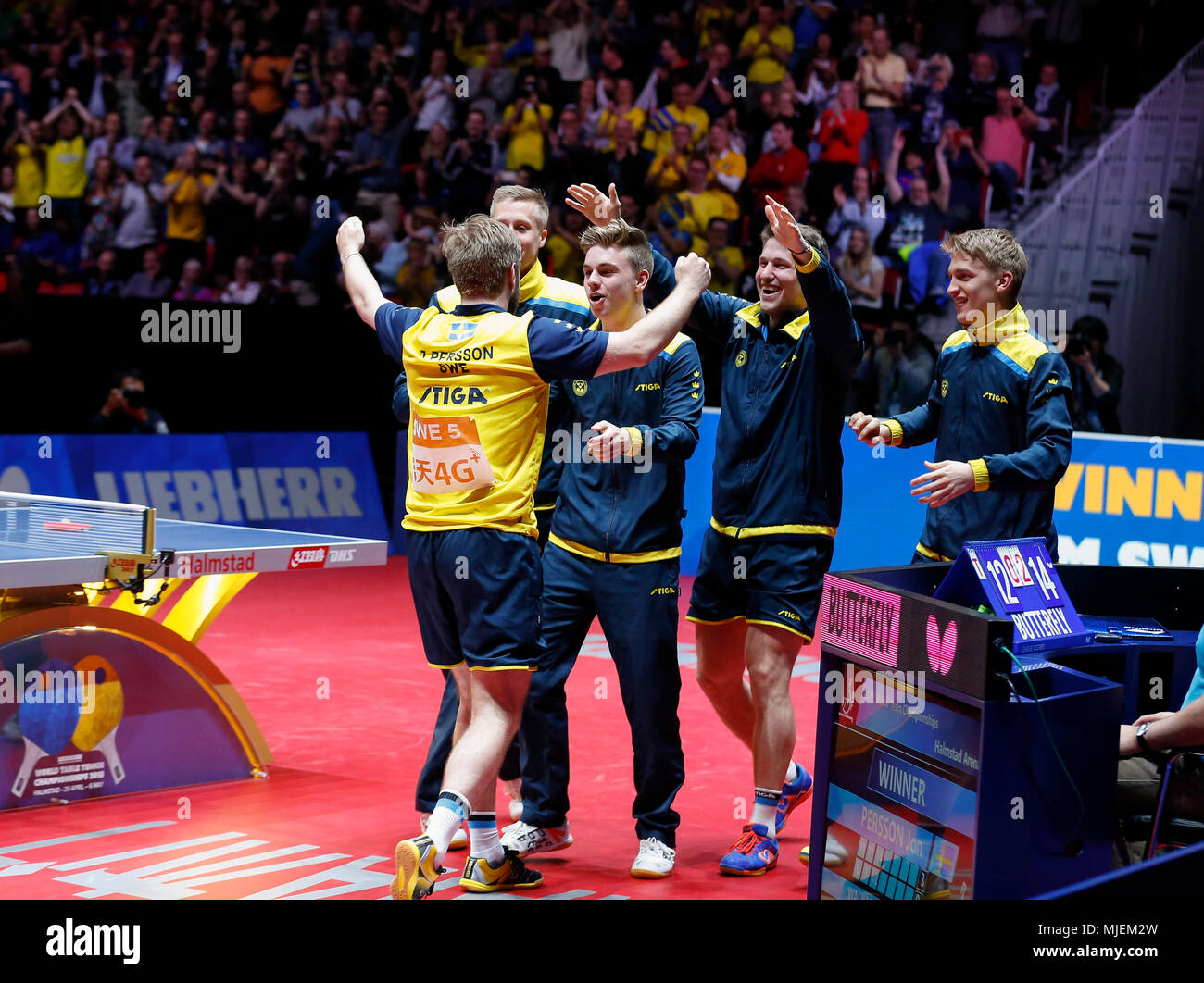 Halmstad, Sweden. 4th May, 2018. Swedish players celebrate after winning the Men's group quarterfinal match against England at the 2018 World Team Table Tennis Championships in Halmstad, Sweden, May 4, 2018. Credit: Ye Pingfan/Xinhua/Alamy Live News - Stock Image