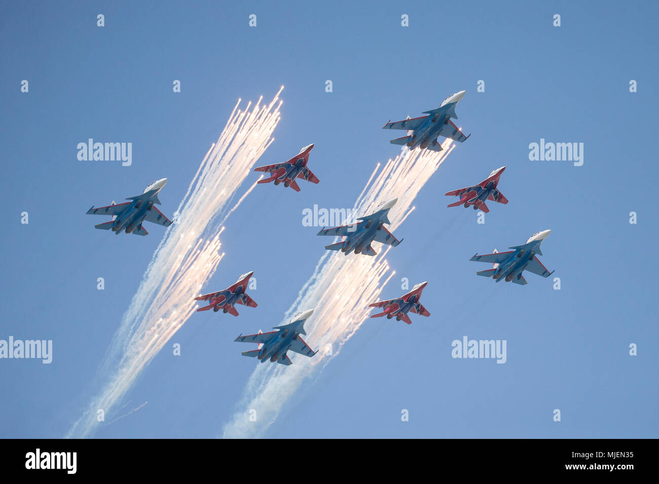 Moscow, Russia. 4th May, 2018. Russian Air Force multi-purpose fighters Su-30SM of the pilot group Russkiye Vityazi (Russian Knights) and MiG-29 of the Strizhi (Swifts) aerobatic team fly in formation during a rehearsal of the upcoming Victory Day air show marking the 73rd anniversary of the victory over Nazi Germany in the 1941-45 Great Patriotic War, the Eastern Front of World War II. Credit: Victor Vytolskiy/Alamy Live News Stock Photo
