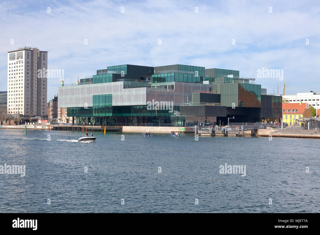 Copenhagen, Denmark. 5th May, 2018. The BLOX building, a new prestige building for architecture and design on Christians Brygge at the waterfront at Frederiksholm Canal next to the Black Diamond in the inner harbour. The building houses the Danish Architecture Centre and a number of companies working with future solutions for cities. The building was inaugurated by H.M. Queen Margrethe II yesterday - today open house to a festive opening day. BLOX is the original name of the old brew-house property where it is situated. Architects OMA. Credit: Niels Quist/Alamy Live News Stock Photo