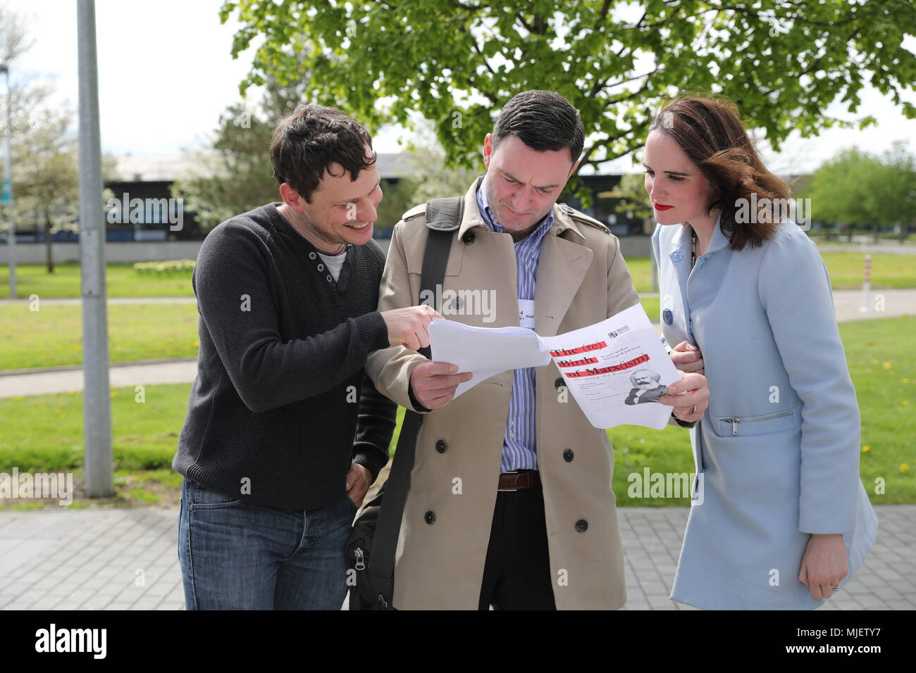 Dublin. 5th May, 2018. People study a program before attending a seminar in Maynooth, east Ireland, May 4, 2018. A two-day international seminar to mark the 200th birthday of Karl Marx opened at Maynooth University in Ireland's eastern city of Maynooth on Friday. Credit: Xinhua/Alamy Live News - Stock Image