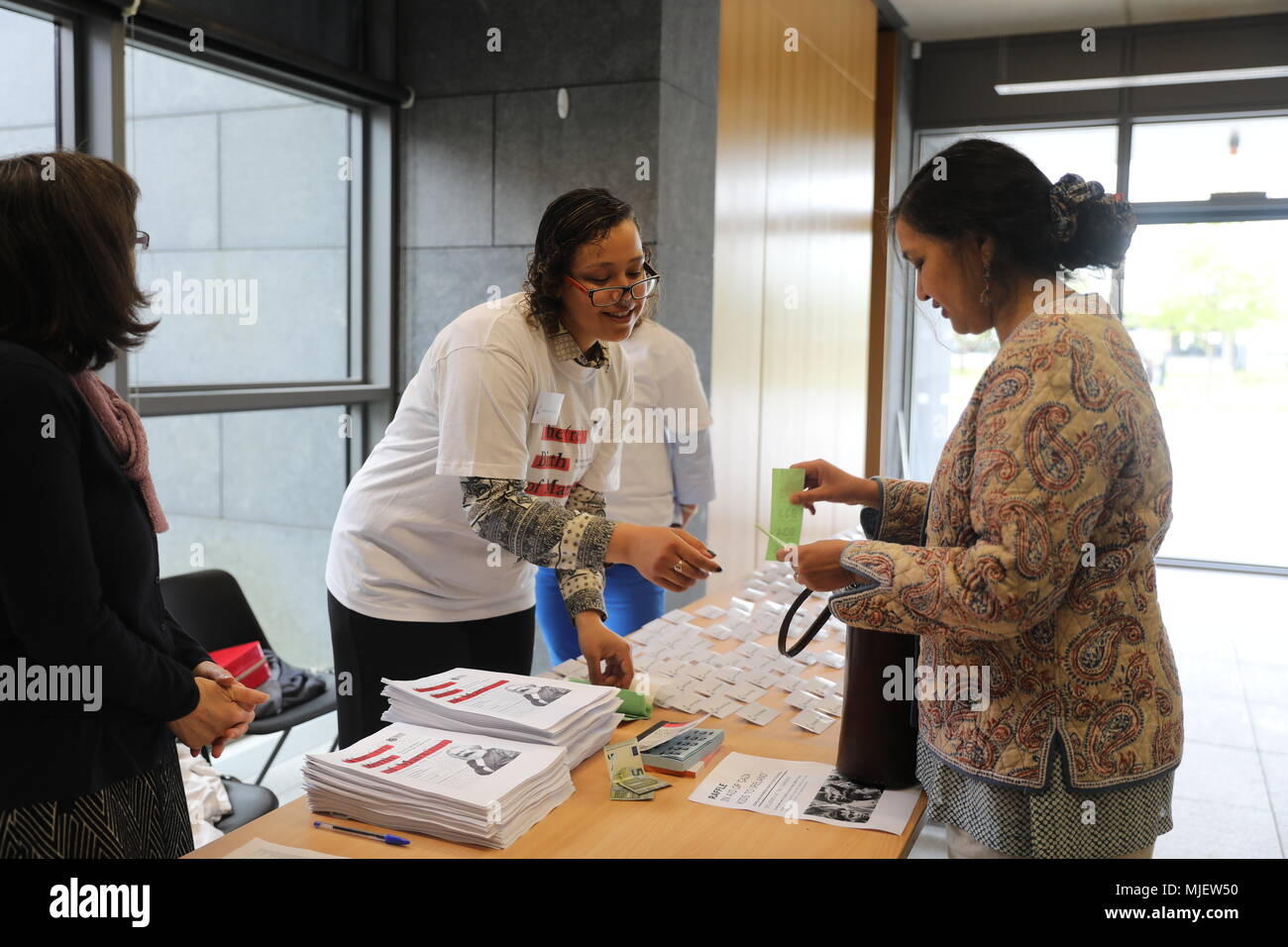Dublin. 5th May, 2018. A delegate registers at a seminar in Maynooth, east Ireland, May 4, 2018. A two-day international seminar to mark the 200th birthday of Karl Marx opened at Maynooth University in Ireland's eastern city of Maynooth on Friday. Credit: Xinhua/Alamy Live News - Stock Image