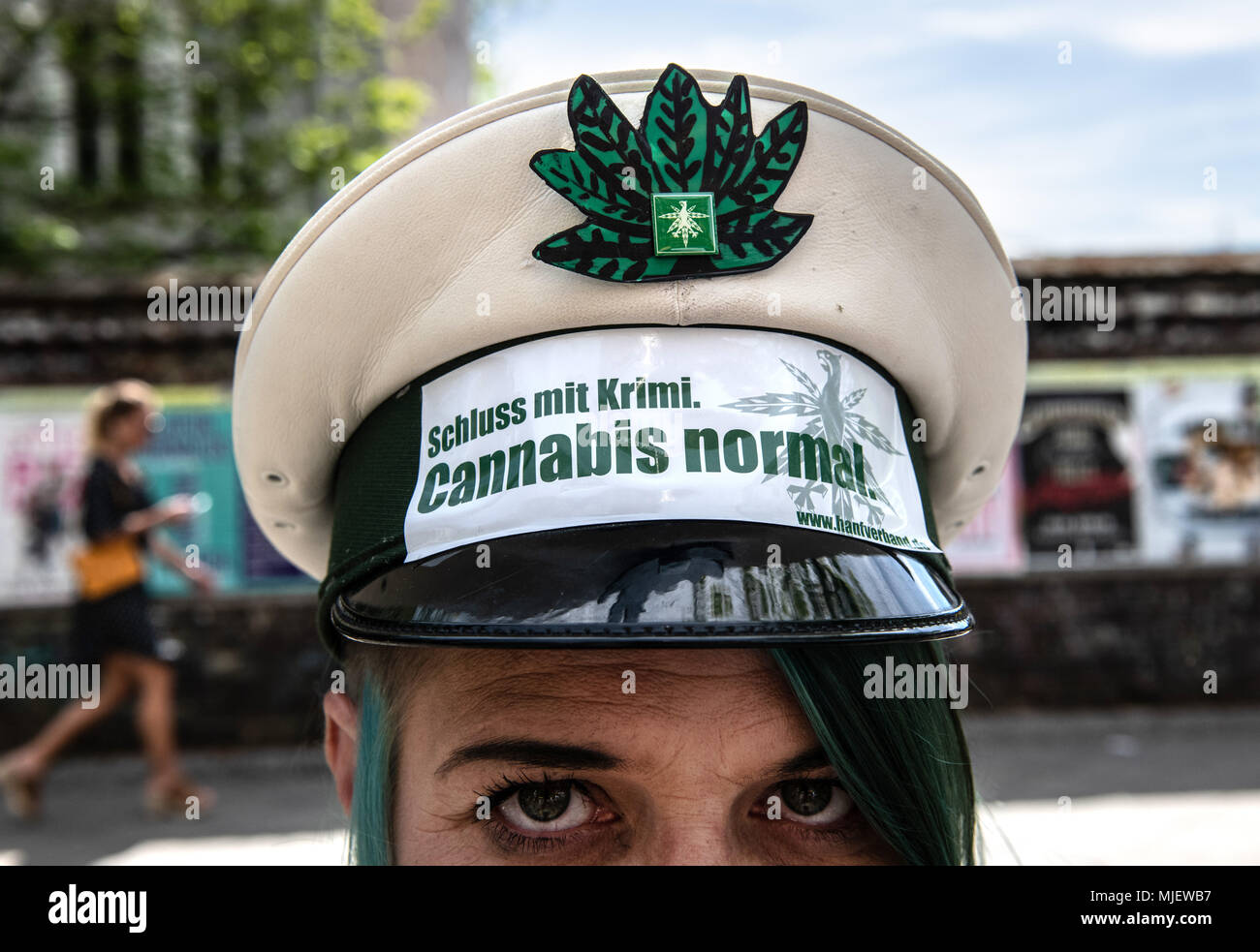 05 May 2018, Germany, Berlin: 'End crime: Cannabis is normal' reads a stylised police hat of a protestor demanding the legalisation of cannabis. Photo: Paul Zinken/dpa - Stock Image