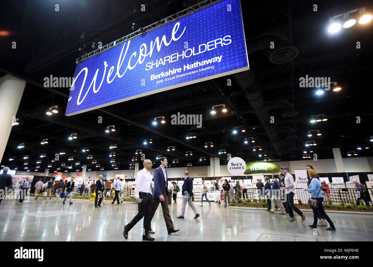 Omaha, USA. 5th May, 2018. People visit an exhibition area for the Berkshire Hathaway's annual shareholders meeting in Omaha, Nebraska, the United States, on May 5, 2018. Berkshire Hathaway held its 2018 shareholders meeting on Saturday, attended by tens of thousands of people from all over the world. Credit: Wang Ying/Xinhua/Alamy Live News Stock Photo